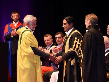 John Francis receiving his Honorary Doctorate from the Chancellor, Sanjeev Bhaskar.